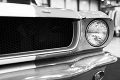 Front view of Classic retro Ford Mustang GT.Car exterior details. Headlight of a retro car. Black and white. Royalty Free Stock Photo