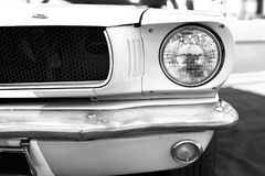 Front view of Classic retro Ford Mustang GT.Car exterior details. Headlight of a retro car. Black and white. Stock Photography