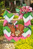Kentucky derby, colorful cutout symbol. Front view, close distance of a kentucky derby, colorful cutout symbol of racehorse, mount and horse shoe in a tropical stock images