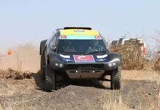 Front view close-up of black CR-2 rally car going down slope Stock Photography