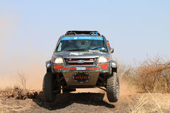 Front view close-up of black Ford Ranger rally car ramping down Royalty Free Stock Photography