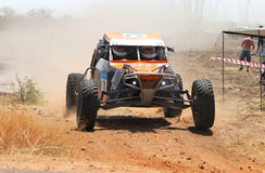 Front view close-up of orange Zarco rally car at road crossing Stock Images