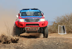 Front view close-up of red and blue Toyota Hilux single cab rally car at road crossing. Sun City, South Africa – OCTOBER 1, 2016: Front view close-up of stock photos