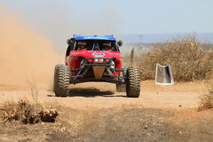 Front view close-up of red Porter rally car pull away at road cr Stock Image