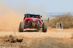 Front view close-up of red Porter rally car pull away at road cr Royalty Free Stock Photo