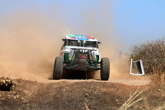 Front view close-up of white Bat rally car pull away at road crossing. Sun City, South Africa – OCTOBER 1, 2016: Front view close-up of white Bat rally stock photo