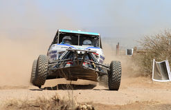 Front view close-up of white Chenowth rally car pull away at roa Royalty Free Stock Photos