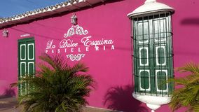 Colonial house in Paraguana peninsule, Pueblo Nuevo, Falcon state Venezuela. Front view for colonial house green and Fucsia converted in bakery in Pueblo Nuevo stock photography