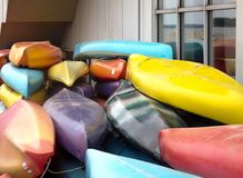 Front view of colorful canoes stacked royalty free stock photography