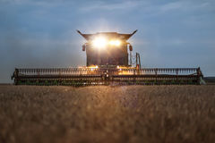 Front view of a combine harvester in the evening Stock Photos