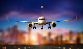 Front view of commercial airplane, blur modern city on background Royalty Free Stock Photography