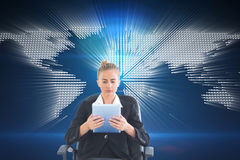 Front view of concentrated chic businesswoman using her tablet Stock Photo