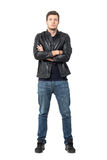 Front view of confident young man in casual clothes with crossed arms looking at camera Royalty Free Stock Photography