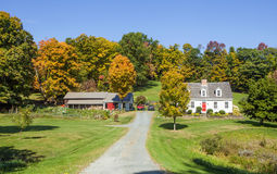 Front View Country Home and Woodshed in Autumn Stock Photo