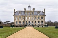 Front view of the country house of Kingston Lacy in Dorset. Showing the house facade, drive way and lawn Stock Photo