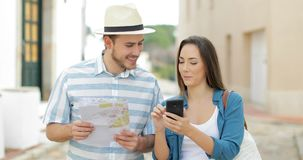 Couple of tourists walking and booking hotel online stock footage