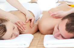 Front view of a couple having a back massage royalty free stock photography
