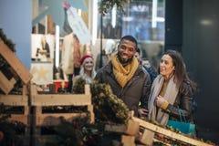 Couple Buying a Christmas Wreath Stock Photos
