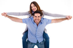 Front view of a couple in piggy back ride Stock Photography