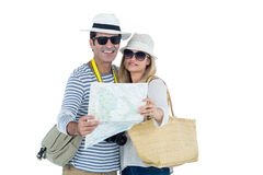Front view of couple reading map. Against white background Stock Photos