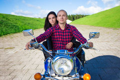 Front view of couple riding on vintage motorcycle Stock Images