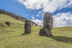 Front view of a couple of underground moai on the extinct volcano Rano Raraku stock photo