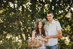 Front view of couple of young boyfriend and girlfriend standing and smiling at camera. Couple holding by hands each other. Brunett Royalty Free Stock Photography