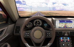 Front view dashboard of modern brand new car with road in the wi Stock Photography