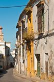 Artisan crafted store fronts on deserted street in Spain. Front view of deteriorating, artisan crafted storefronts and bared windows on a deserted street in the royalty free stock image