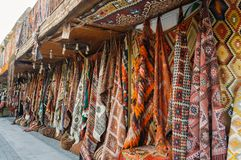 front view of different carpets at market stock image