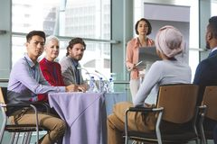 Business people looking at camera in a business seminar royalty free stock image