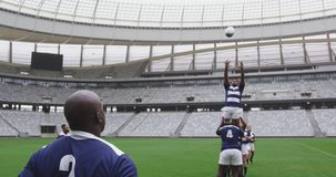 Male rugby players playing rugby match in stadium 4k stock video footage