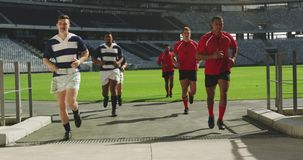 Male rugby players returning the dressing room after the match 4k stock video