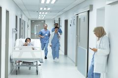 Medical team running in the corridor at hospital stock image