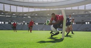 Rugby players playing rugby match in stadium 4k stock footage