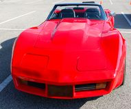 Front view of early 1970's model red antique Corvette. 1970's model red corvette in  pristine showroom condition Stock Images