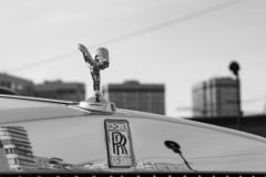 Front view of emblem Spirit of Ecstasy of new a very expensive Rolls Royce Phantom car, a long black limousine, model outdoors on royalty free stock photo
