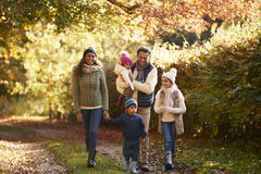 Front View Of Family Enjoying Autumn Walk In Countryside imagen de archivo libre de regalías