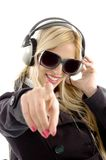 Front view of female enjoying music and indicating. On an isolated white background Royalty Free Stock Photos