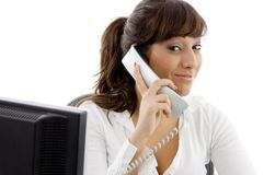 Front view of female executive talking on phone Stock Image