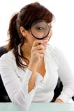 Front view of female looking through lens Stock Photos