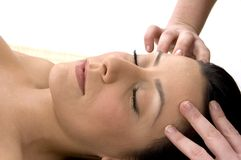 Front view of female taking head massage Stock Image