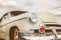 Front view of a fifties American car. Retro styled front view of a fifties American car royalty free stock photography