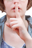 Front view of finger near lips - hand gesture Stock Photography