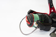 Front view of fishing reel on the white background Royalty Free Stock Photos