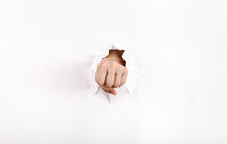 Front view of the fist punches a paper Stock Images