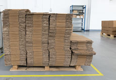 Front view of folded cardboard boxes in assembly hall Royalty Free Stock Images