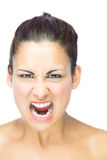 Front view of furious brunette woman yelling at camera Royalty Free Stock Images