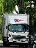 Front View Of A GDExpress Truck. Front view of a GDExpress or GDEx truck, out on delivery, coming down a narrow street in Ipoh, Malaysia Stock Images
