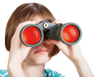Front view of girl looks through binoculars Stock Photo